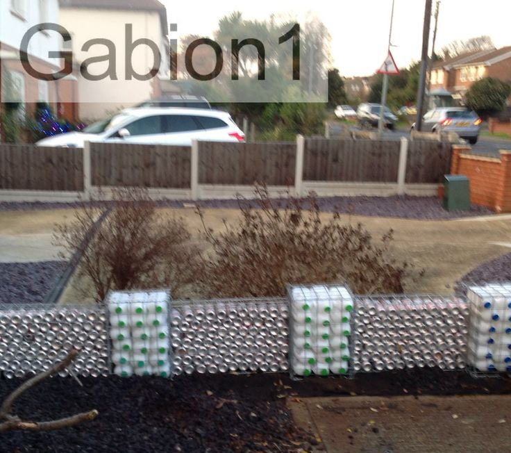 Gabion Wall Filled With Recycled Cans And Plastic Bottles