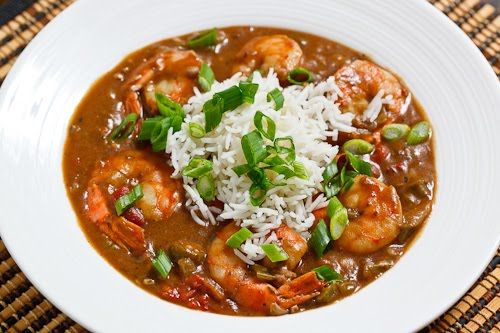 Shrimp and Okra Gumbo Slow Cooker: Implement step 1, optionally implement steps 2-4, place everything except the shrimp, green onions and parsley in the slow cooker and cook on low for 6-10 hours or high for 2-4 hours before adding the shrimp and cooking for another 10 minutes.