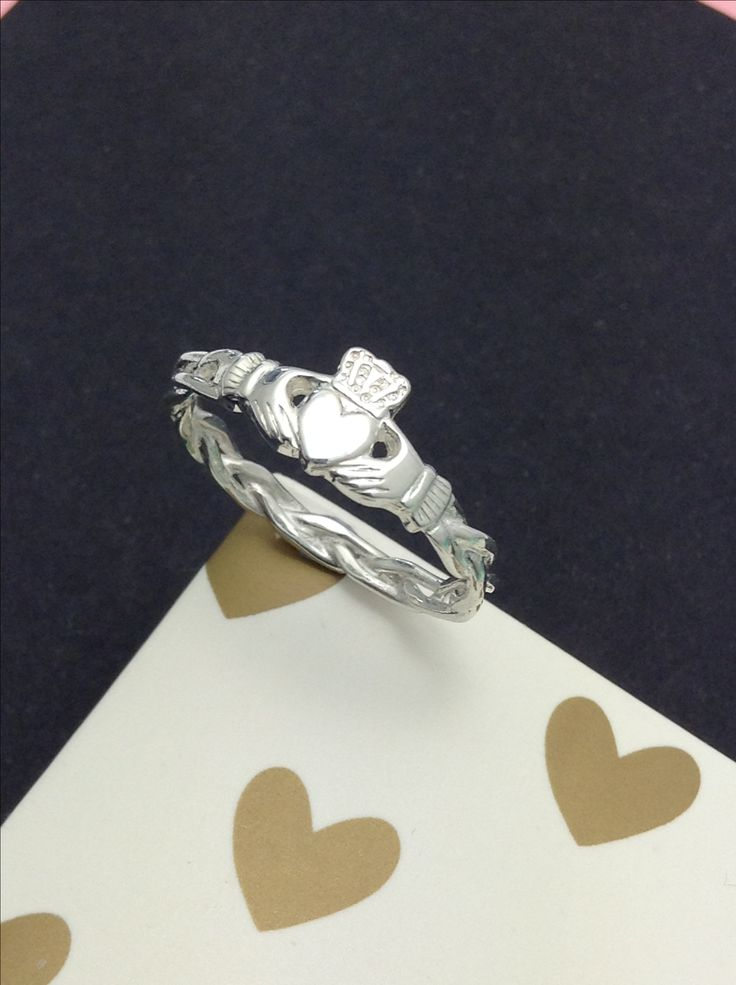 Dainty claddagh ring on celtic rope band.