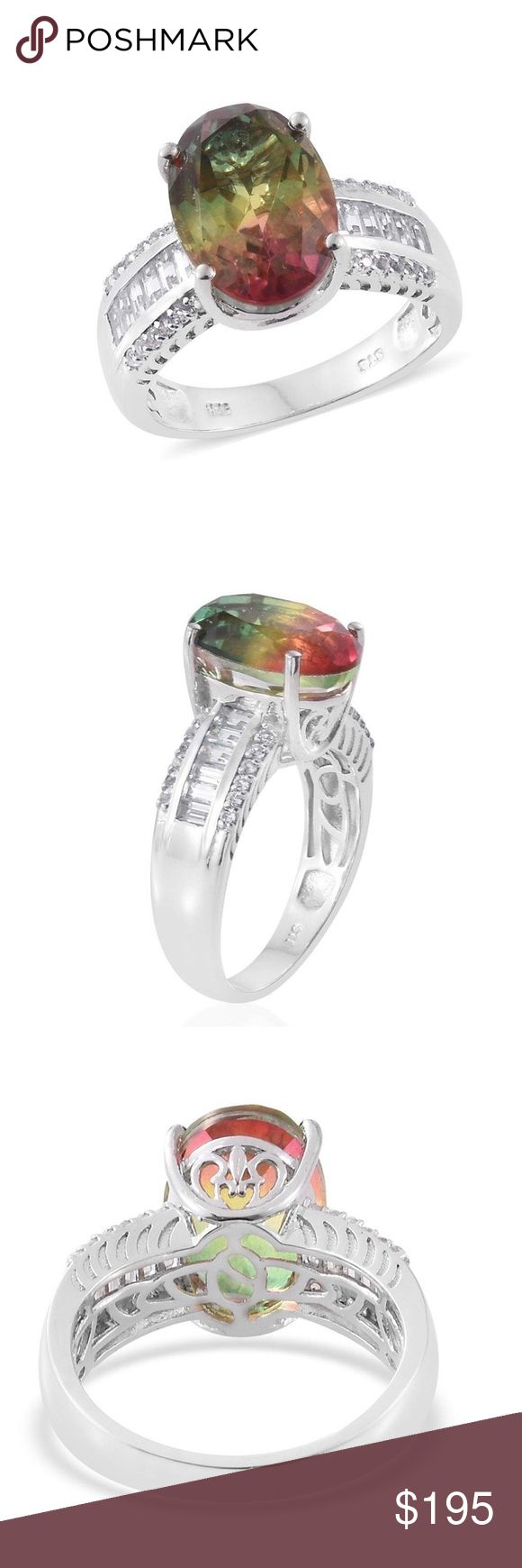 Rainbow Genesis Quartz, White Topaz Platinum 925SS Embellish your everyday look with this rainbow quartz ring. Accented with white topaz, the piece is set in platinum over 925 sterling silver. Pair it with any outfit.  Timeless of a look that will never go unnoticed. Total Stone Weight (Carat) 8.260 Gemstone 1 Rainbow Quartz Oval 14x10 Faceted Gemstone Count 1 1 7.3 Gemstone 2 White Topaz Baguette 3x1.5 Faceted Gemstone Count 2 12 Gemstone Weight 2 0.720 Gemstone 3 White Topaz Round 1.2…