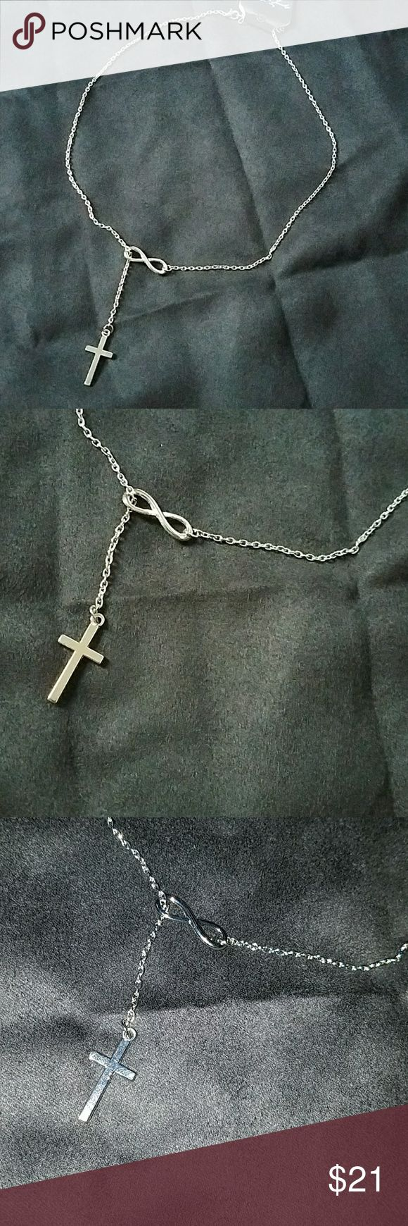 NEW Lovely Infinity Cross Necklace Cross passes thru the infinity  Unique and very pretty Never worn Jewelry Necklaces