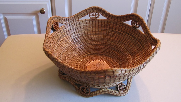 This basket is made with pine needles, black walnut slices and a leather round.