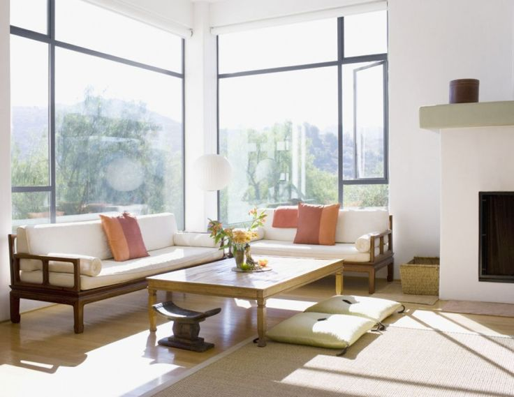 Calming Japanese Living Room With Wooden Furniture And Floor Cushions