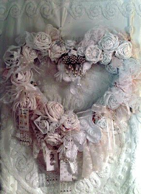 Beautiful shabby chic wreath, is that button cards attached to it... GORGEOUS!