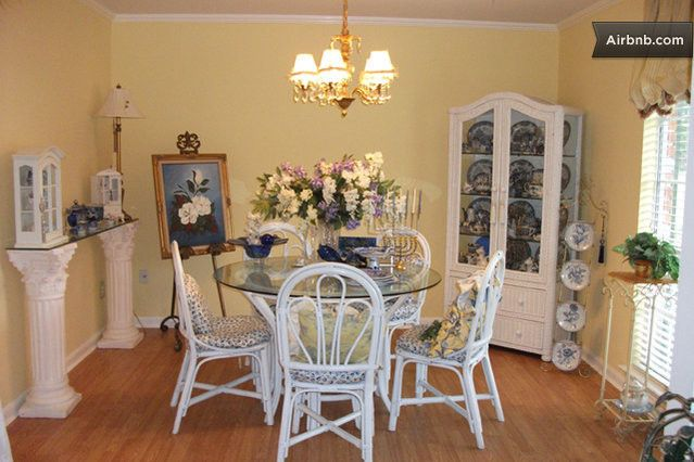 Baton Rouge Apartments  : Choose Your Location: Amazing Baton Rouge Apartments With Luxury Dining Table Set Glass Top Table Also Cute Chandelier Along With Flowery Picture Hard Wood Flooring Small Window Installation Beige Curtain Window ~ surrealcoding.com Apartments Inspiration