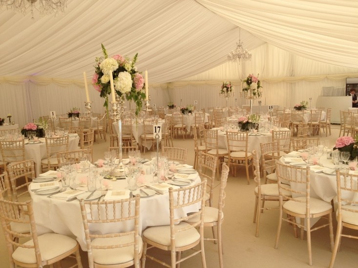 Mixture of Candelabras and low floral displays to give less formal look
