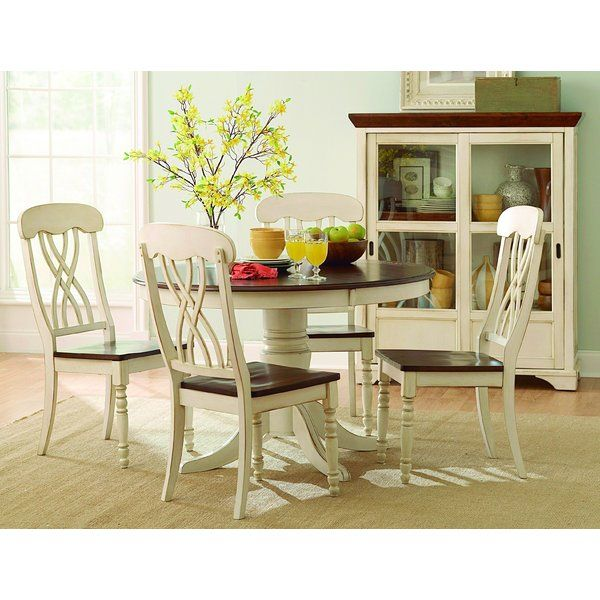 The design of Scottville collection captures the essence of a casual country home. Its antique finish give it a striking two-toned appearance. The solid wood table top and turned legs complement Scottville collection with a touch of elegance. It's a warm look you'll love having in your home.