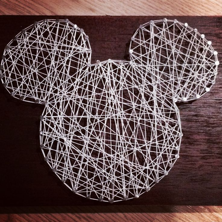 This super easy nail string art made the perfect edition to my Disney DVD display! #Disney #DisneyCollector #DIYDisney