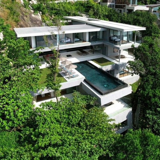 """Villa Amanzi in Phuket, Thailand.  The poster said: """"I think I just found heaven, and it turns out it's in Phuket Thailand. Designed by Hong Kong based Original Vision, the home is a combination of an amazing site and a thoughtful and thoroughly modern home. It's hard not to [see] references to Falling Water [by Frank Lloyd Wright].""""  I agree; very much the same impression as Falling Water."""