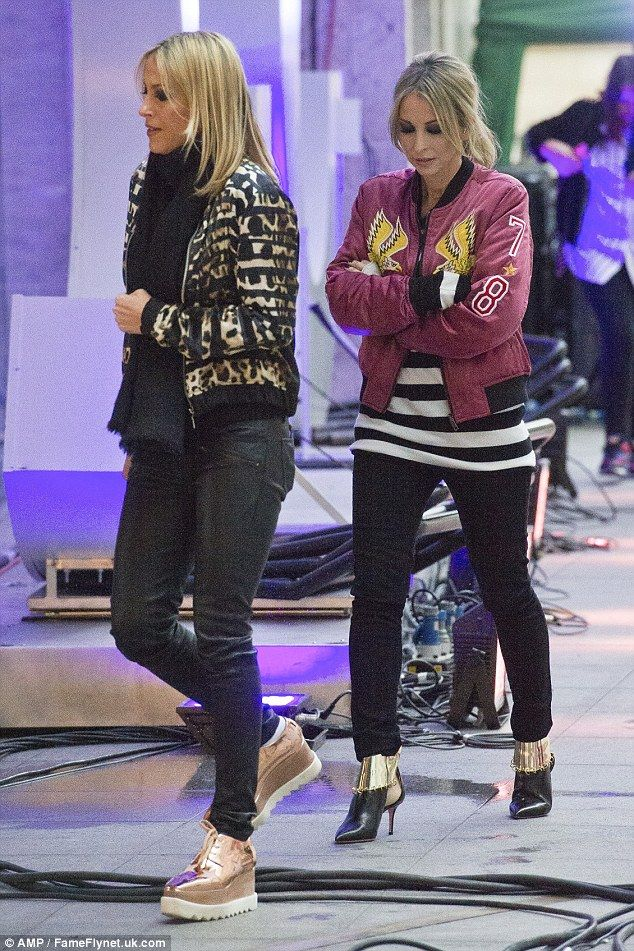 Looking cool: Sisters Nicole (left) and Natalie Appleton (right) were in their best garbs ...