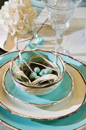 The natural textures of this place setting really stand out with a pop of robin's egg blue.