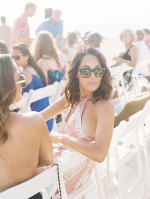 Wedding guest dress ideas pink halter neck sunglasses wedding outdoor Malibu beach CJ Perry Lana