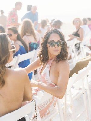 Wedding guest dress ideas pink halter neck sunglasses wedding outdoor Malibu beach CJ Perry Lana