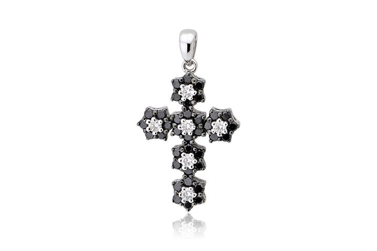Cross with black and white brilliant cut diamonds 0,58CT made by 18K white gold. Σταυρός με μαύρα και λευκά διαμάντια μπριγιάν κοπής 0,58CT από λευκόχρυσο 18Κ. Price: 650 €
