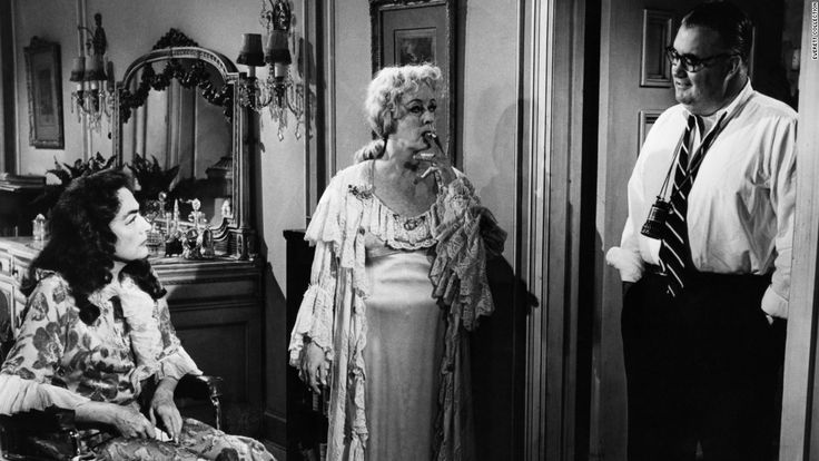 """Crawford approached director Robert Aldrich, right, about teaming her with Davis in the """"Sunset Boulevard""""-type story of two show-biz sisters trapped in a decaying Hollywood mansion -- one crippled emotionally, the other in a wheelchair. """"Baby Jane"""" became a sleeper hit when released in the fall of 1962. It revitalized the careers of Davis and Crawford and created a Hollywood genre in the '60s: schlocky horror films starring aging actresses."""