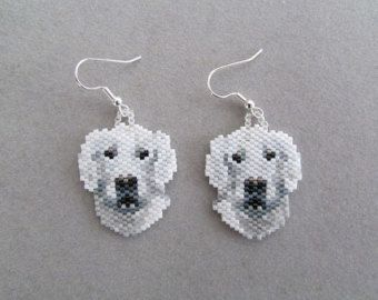 These adorable little beaded West Highland Terrier earrings are sure to be a favorite of the Westie owner or dog lover that you know. They measure about 1-3/4-inches wide and 1-1/2-inches long. They are made from approximately 896 tiny seed beads intricately woven, one at a time, with a needle and thread to create the finished earrings you see here.  The pierced fish-hook ear wires are silver-plate over surgical steel. If you prefer your little Westies to dangle from the post type or clip on…