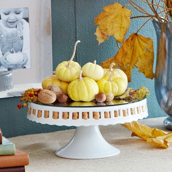Top a cake stand with gourds for a simple fall display. More ideas for #fall #decorating: http://www.bhg.com/decorating/seasonal/fall/easy-fall-decorating-projects/?socsrc=bhgpin110112cakestandpumpkins#page=10