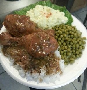 Smothered Chicken With Brown Gravy Rice Green Peas And
