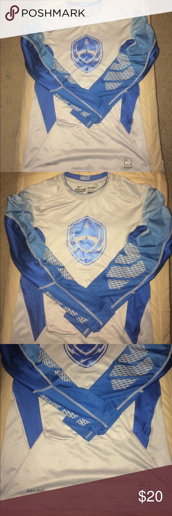 Nike compression longsleeve shirt men's sz Large Nike dri-fit compression longsleeve shirt men's size large. Used but in very good condition no holes stains or tears. Shirt has Nike football logo on the front. Please look closely at all pictures before purchasing. Nike Shirts Tees - Long Sleeve