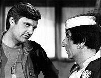Alan Alda Jamie Farr Hawkeye and Klinger MASH 1977.JPG