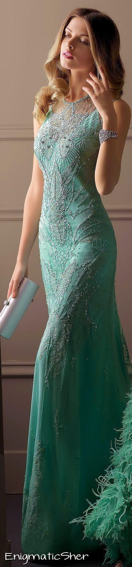 I like the dress. The model looks like she's about to sneeze though...