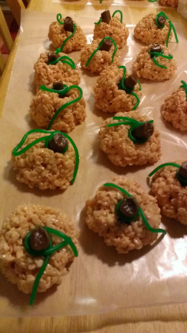 Rice Krispie Treat Pumpkins. A Tootsie Roll or a Rolo works great as the stem. I used green apple Twizlers for the vines.