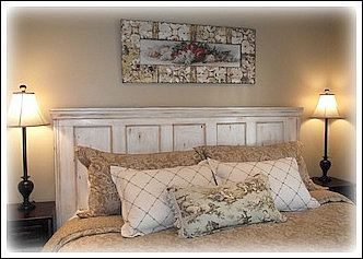 This headboard is one of my favorite Cottage Style decorating ideas! It was made from an old door. My husband added wood molding to frame the door into a headboard. Then I painted it white, and gave it a distressed look using antiquing glaze. This beautiful headboard is in our master bedroom.