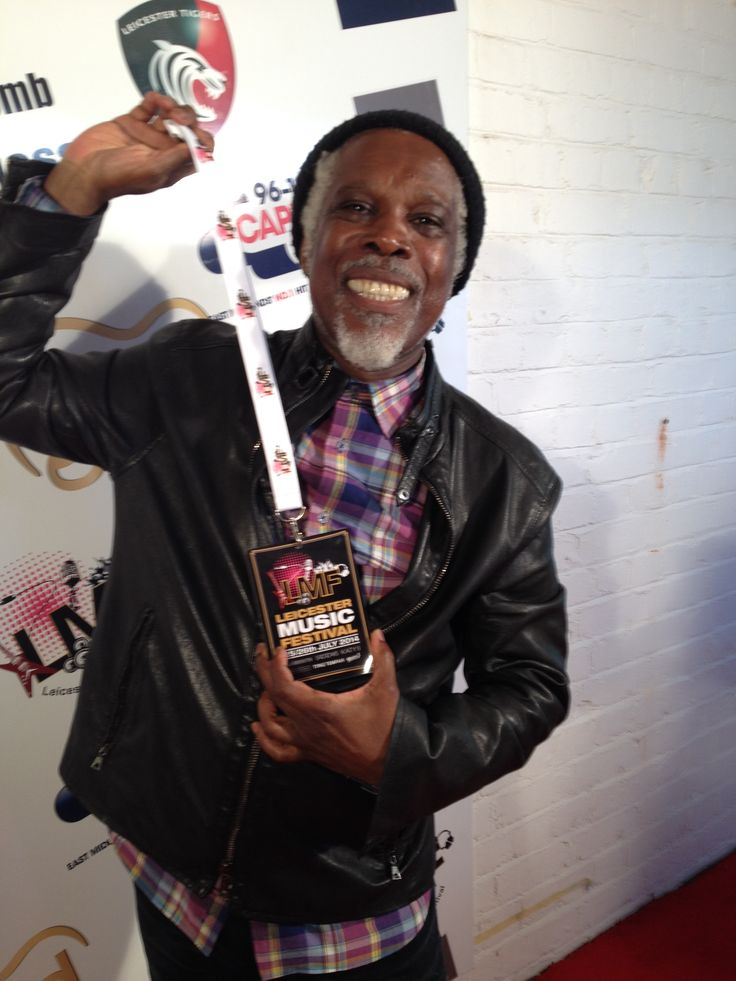 Billy Ocean showing off the official Leicester Music Festival Lanyard