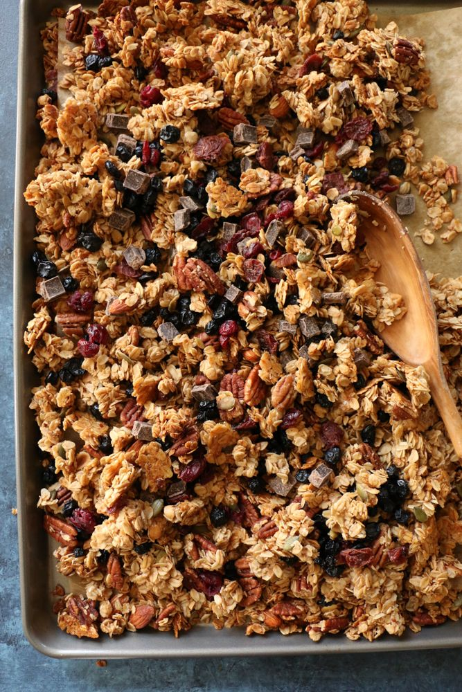 Gluten Free Trail Mix Granola! Made with gluten free rolled oats, pecans, pepitas, dried fruit, coconut oil and naturally sweetened with some honey and maple syrup. You just can't beat freshly baked homemade granola! You've got to try this!