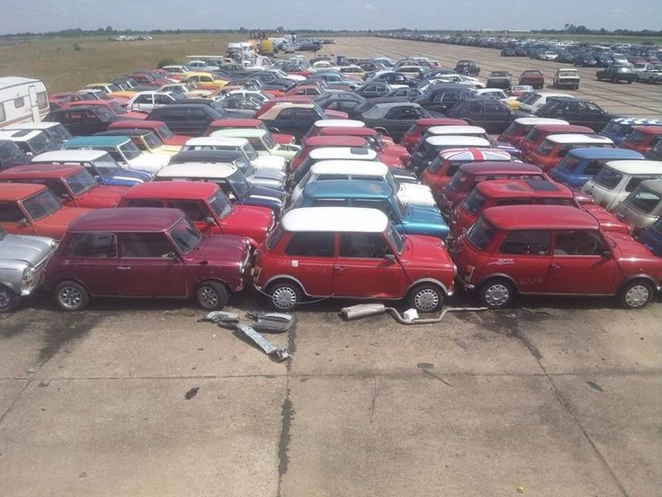 minis at an airfield in bedfordshire waiting to be crushed under the goverment car scrappage scheme
