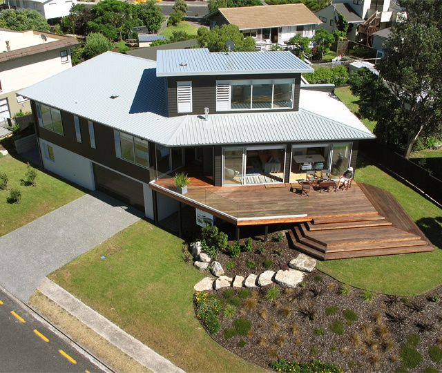 The original home forms the guest wing in this exquisitely renovated three level beachfront home.