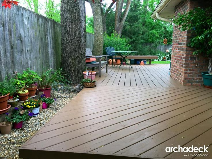A platform deck with deck board pattern blends the structure and yard