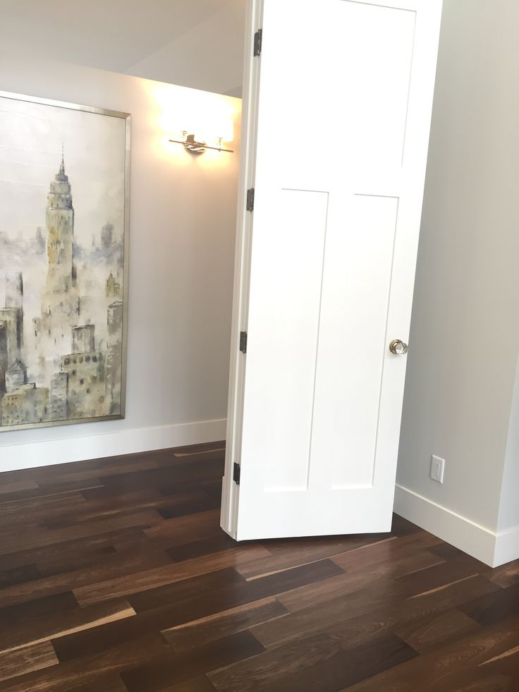 Beautiful corridor from a Showhome featuring Lauzon's Organik Hard Maple hardwood flooring Charm. This flooring features the exclusive air-purifying technology called Pure Genius technology. Project realized by Wolf Custom Homes in the Rocky View County (Springbank). #corridor #stairs #interiordesign #hardwoodfloor #artfromnature