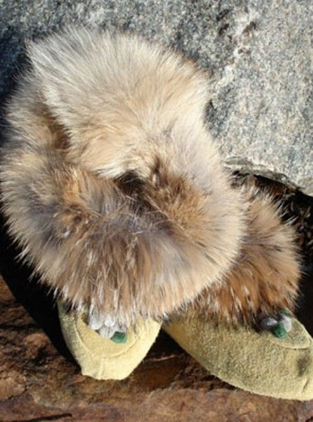 coyote fur! $200 this shop ships to nz $40 surface; $60 airmail. Lots of other moccasins, many much cheaper