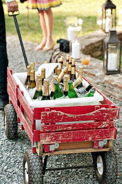 Have an old wagon or wheelbarrow? Fill with ice, and voila - a beverage cart with a rustic feel!