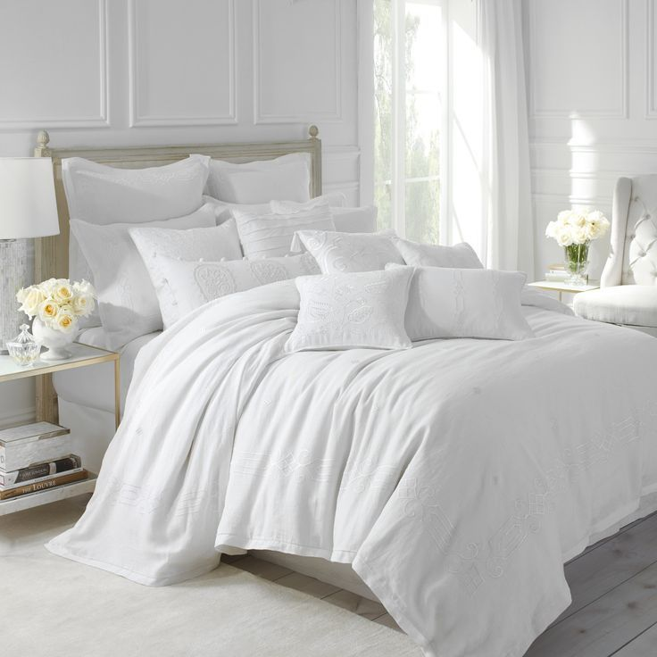 The rich elegance of the Somerset Duvet brings a sense of regal sophistication to any bedroom. The 100% crisp white linen is embroidered with a silky white damask (tonal embroidery) print in satin stitch.