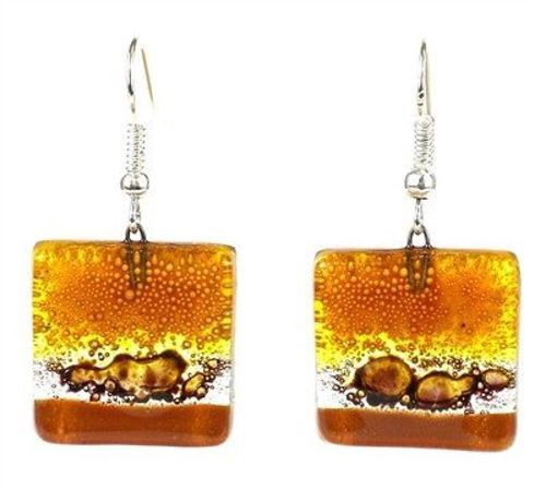 These square glass earrings are handmade in Chile. Measuring 0.75 inches square these earrings feature a earthtone design and hang from hypoallergenic hooks. Meet the Artisans Calypso Chile is a famil