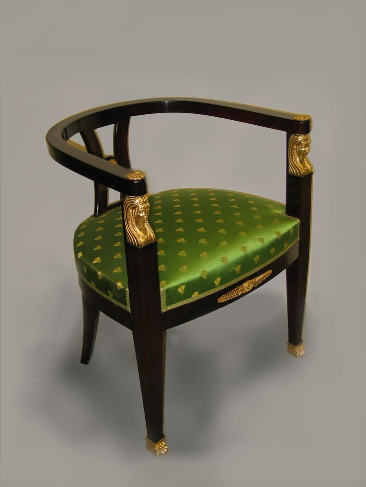 An Empire Style Mahogany Desk Chair with Gilt-Bronze Mounts  French, Circa 1900.