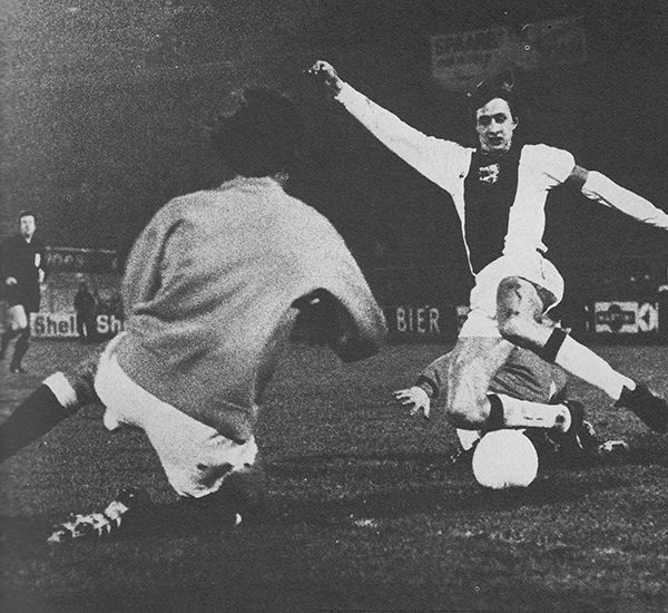 16th January 1973. Ajax striker Johan Cruyff holding off Rangers defender John Greig with goalkeeper Peter McCloy coming off his line in the European Super Cup 1st Leg, at Ibrox.