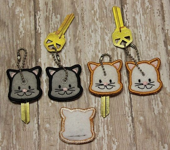 Cat key cover, key chain, embroidered, keychain, key fob, keyfob, embroidery, gift, stocking stuffer, party favor, grab bag, animal by DesignsByRAJA on Etsy https://www.etsy.com/listing/255411436/cat-key-cover-key-chain-embroidered