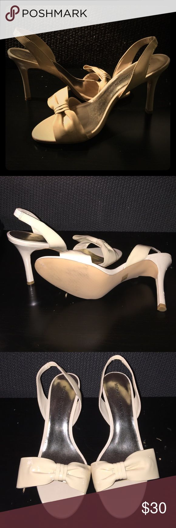 Beige Strappy High Heels. Beige patent leather shoe. Sling backs with a bow shaped front. Brand new, never worn. Michael Shannon Shoes
