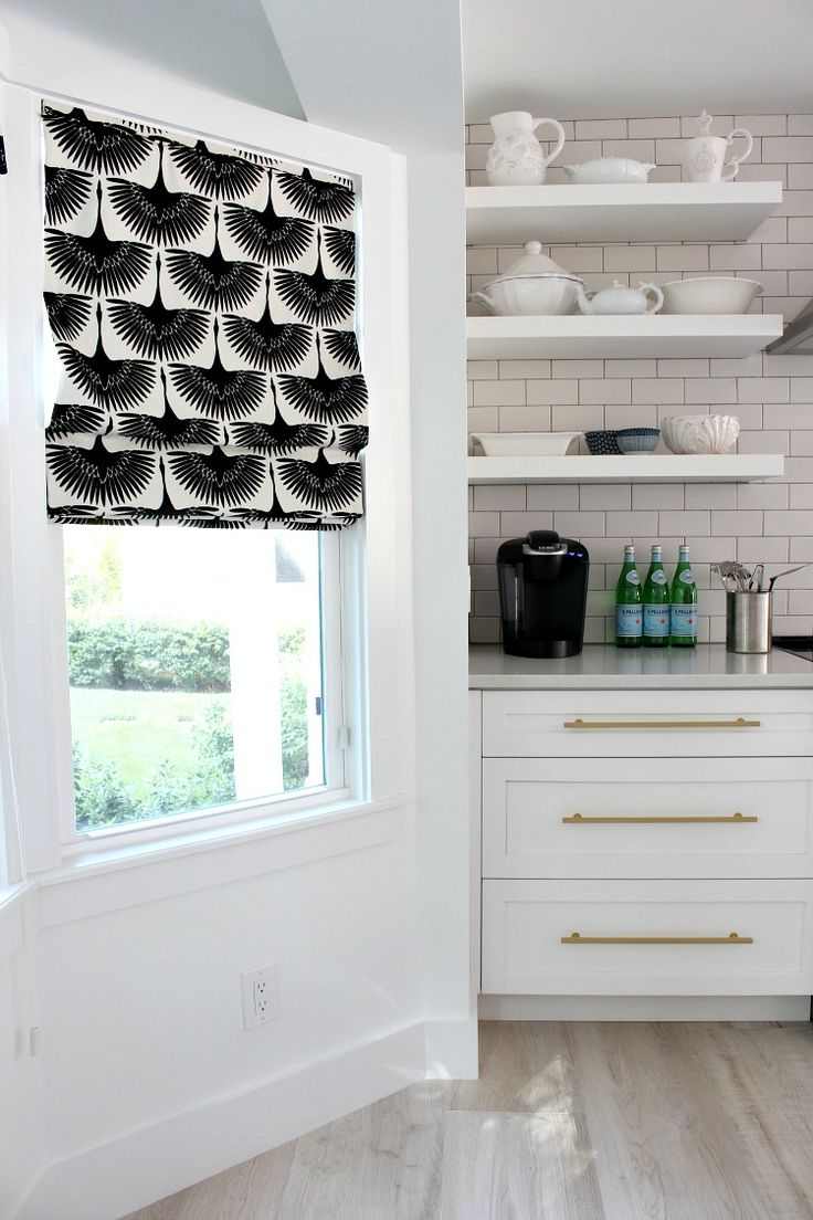 The beach cottage kitchen recently got some fabulous new roman blinds featuring the gorgeous fabric line by Genevieve Gorder.