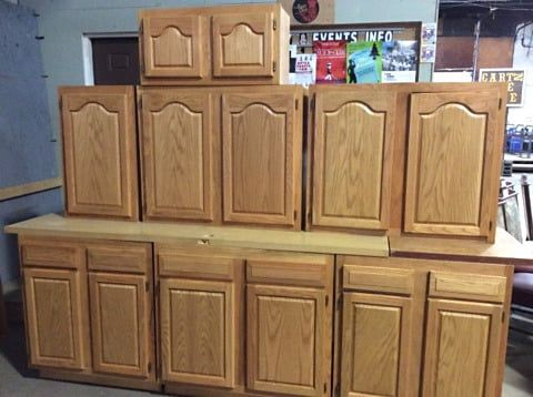 That's a great looking set of cabinets! Like new and never used, this surplus kitchen set features oak plywood fronts.