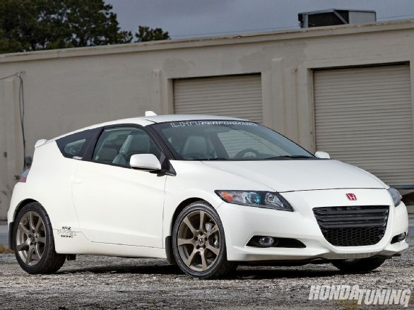 Check out John Wilson's 2010 Honda CR-Z.  John is no stranger to K-swapped vehicles having built a K-swapped Honda Insight in the past.  He gave this CR-Z the same treatment, swapping in a 2009 K20Z3 engine. - Honda Tuning Magazine