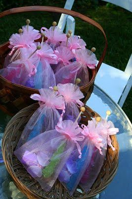 Party favors. Rock candy, bubbles, butterfly clip