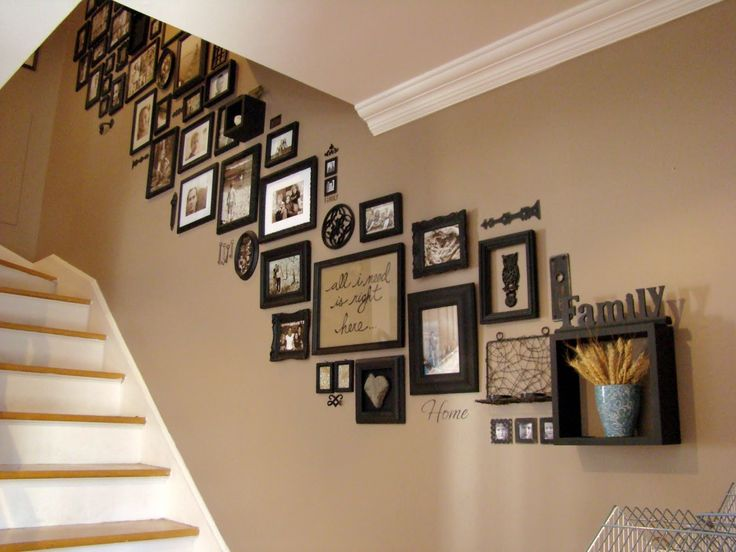 stairway photo gallery - loads of photo frames, all different styles, but painted one colour - awesome!