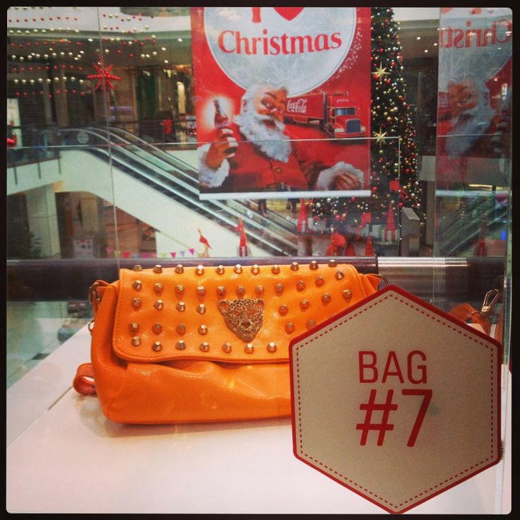 Bag SEVEN: Fun, funky and flirty! This bright orange purse from Wonderland is your BFF on your next girl's night out.