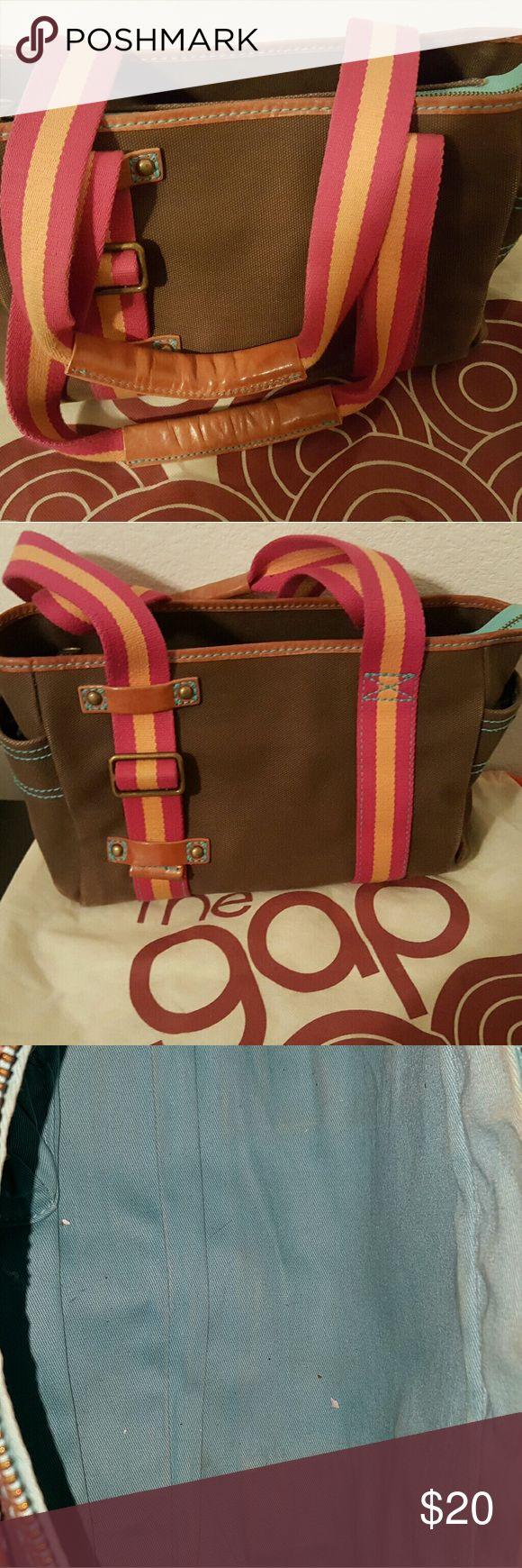 Vintage 1969 Tote from The Gap Canvas type material. Brown with Pink/Orange straps. Interior is turquoise. Slightly used. The corners are a little discolored. Comes with original cloth bag for safe keeping. GAP Bags Shoulder Bags