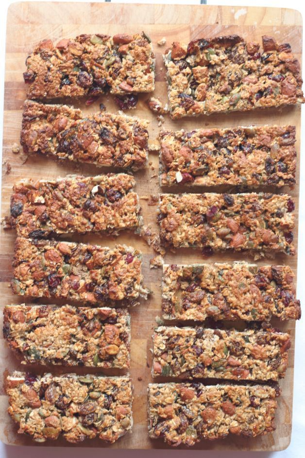 These healthy fruit and nut snack bars are tasty, chewy, filled with fruits, nuts and seeds, vital vitamins and minerals. Plus they're only 200 calories each! Make your own snacks, like these and you wont be filling yourself with refined sugar!