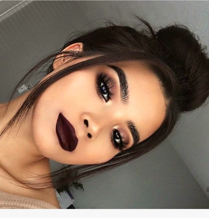 now this is a statement makeup look with dark lips and a dark eye to match